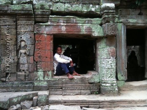 Man at Preah Khan, forest temple of Angkor